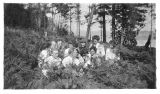 Group seated in the foliage, probably Washington, circa 1911