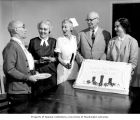 Patients & staff surrounding a Christmas Seal Birthday cake at the Mountain View Sanatorium,...