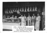 Meat cutters standing in front of The Pork House at the Sanitary Market in Seattle, Washington,...