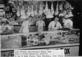 Bob Ford, Reg Norman, and Joe Ford behind the counter at Joe Ford's Universal Meat Box, Seattle,...
