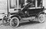 "Man in Ford Model T with ""Carstens Packing Co."" painted on the side,  circa 1917"