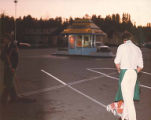 Clerks at Lucky Stores parking lot sweeping and painting lines in Seattle, Washington, 1983
