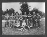 Amalgamated Meat Cutters and Butcher Workmen of North America, Local 81's baseball team in a park,...