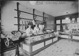 Emil Otten and Bud Tibbatts working at meat market at 1423 W. 63rd St., Chicago, 1928