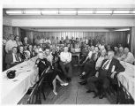 Union members around tables at a conference, circa 1950