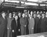 Group of union members wearing suits inside a packinghouse, circa 1947