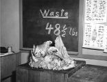 Meat waste on table at the Apprentice Meatcutting School, Edison School, circa 1950