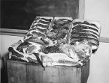 Meat displayed on table in a meat cutters' apprenticeship classroom, Edison School, circa 1950