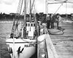 Men on dock next to boat Majestic on the Bornstein Dock in Bellingham, Washington, October 1949