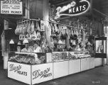 Meat cutters standing behind the counter at Dan's Meats at the Pike Place Market in Seattle,...