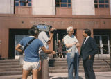 Hirabayashi and Floyd Schmoe outside the United States Courthouse with KCTS Seattle reporter,...