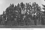 Students and visitors seated on grandstand, Tulalip Indian School, Tulalip Indian Reservation, ca....