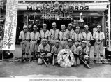 Seattle Asahi baseball team standing in front of Mizuno Bros. sporting goods store, n.d.