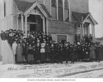 Older Girls Conference attendees on steps of church building, Anacortes, January 1916