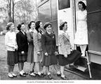 Young women lined up outside mobile x-ray unit while nurse waits in doorway, Seattle and King...