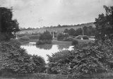 Bridge over pond and monuments in Spring Grove Cemetery, Cincinnati, Ohio, circa 1895-1900
