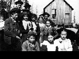 Home Colony, school children in front of first school house, ca. 1900