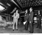 Representative Brock Adams inspecting a DC-9 jet airliner with McDonnell Douglas officials in Long...