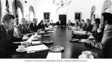 Secretary Brock Adams in a meeting with President Jimmy Carter and other cabinet members,...