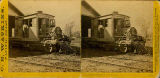 "Man standing on the cab of a train engine called ""Betsey Baker"" near the Cascades Rapids..."