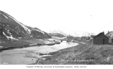 View looking up the Iliuliuk River towards Unalaska and mountains, ca. 1912