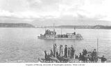 Stern wheel steamer passenger ferry bringing passengers from the MARIPOSA to the dock at ...