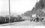 Automobiles on the road between the dock and town of Cordova, ca. 1912