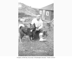 Man with malamute dog and puppy, Libbyville (now Naknek), ca. 1912