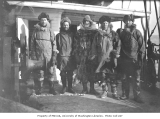 "Dog sledders (""Mushers""), five men in arctic dress, ca. 1910"