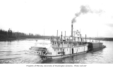 Sternwheel steamship GENERAL J.D. JACOBS pushing barge on Yukon River, ca. 1920