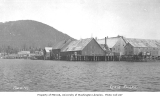 Craig from the water, showing cannery buildings, ca. 1912
