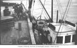 Loading cargo onto cannery tender RED ROVER, Port Moller, ca. 1912