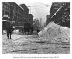 2nd Ave. looking south toward the Hotel Savoy and L.C. Smith Building after the Big Snow of 1916,...