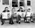 Four seated Lake Washington Shipyard workers reading On the Ways, Houghton, April 21, 1944