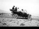 Women and children on outing with automobile, ca. 1910
