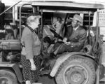 African American man sitting in vehicle talking to older woman, Lake Washington Shipyard,...