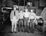 Group photo of three sailors and a lieutenant on midship deck, Houghton, April 7, 1945