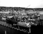 Lake Washington Shipyard docks with ship under construction in foreground and U.S.S.R. ship docked...