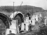 Three arches and six piers at various stages, Martin's Creek viaduct construction, Kingsley,...