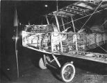 Front view ofa JN 4-D Curtiss biplane cockpit skeleton, circa 1917-1919