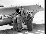 Man boarding United Air Lines Boeing 247 airplane, n.d.