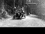 Tourists in automobile at the entrance to Mount Rainier National Park, ca. 1920