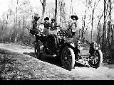 Group on an outing with automobile, ca. 1911