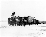 Northern Pacific train crossing the Missouri River on tracks over the ice near Bismarck, North...
