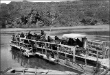 Snake River ferry transporting horse-drawn wagon, n.d.
