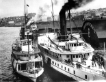 Steamers HASSALO and OLYMPIAN at the Oregon Improvement Co. dock, Seattle, n.d.