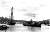 Three masted schooner J.M. WEATHERWAX being towed by the tug TRAVELER, Hoquiam River, n.d.