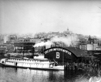 Stern wheel steamboat HASSALO at the Oregon Improvement Co. dock, Seattle, n.d.