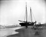 Wreck of the power schooner DUXBURY on the beach at Nome, Alaska