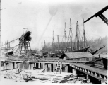 Schooner PIONEER at a lumber mill dock, Hoquiam,  ca. 1892